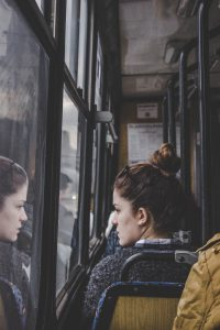Young woman commuting to work on bus