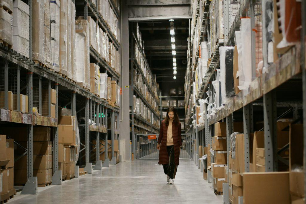 woman walking through warehouse